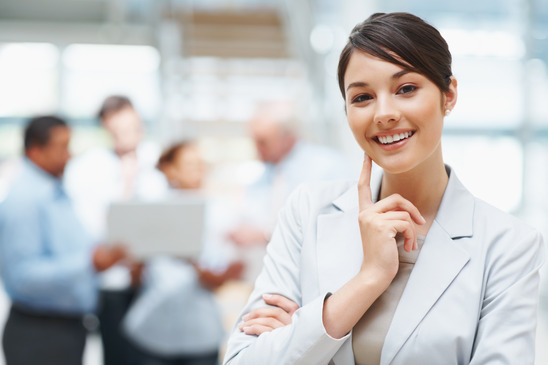 photodune-202687-smiling-cute-business-woman-with-colleagues-at-the-back-xs